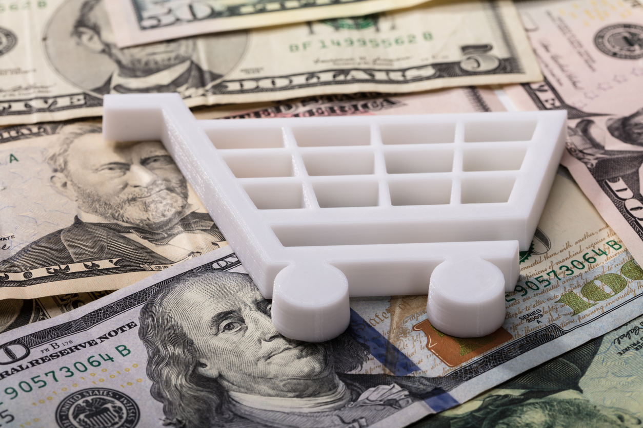 Online Sales Tax: Close-up Of White Shopping Cart On Dollar Banknotes