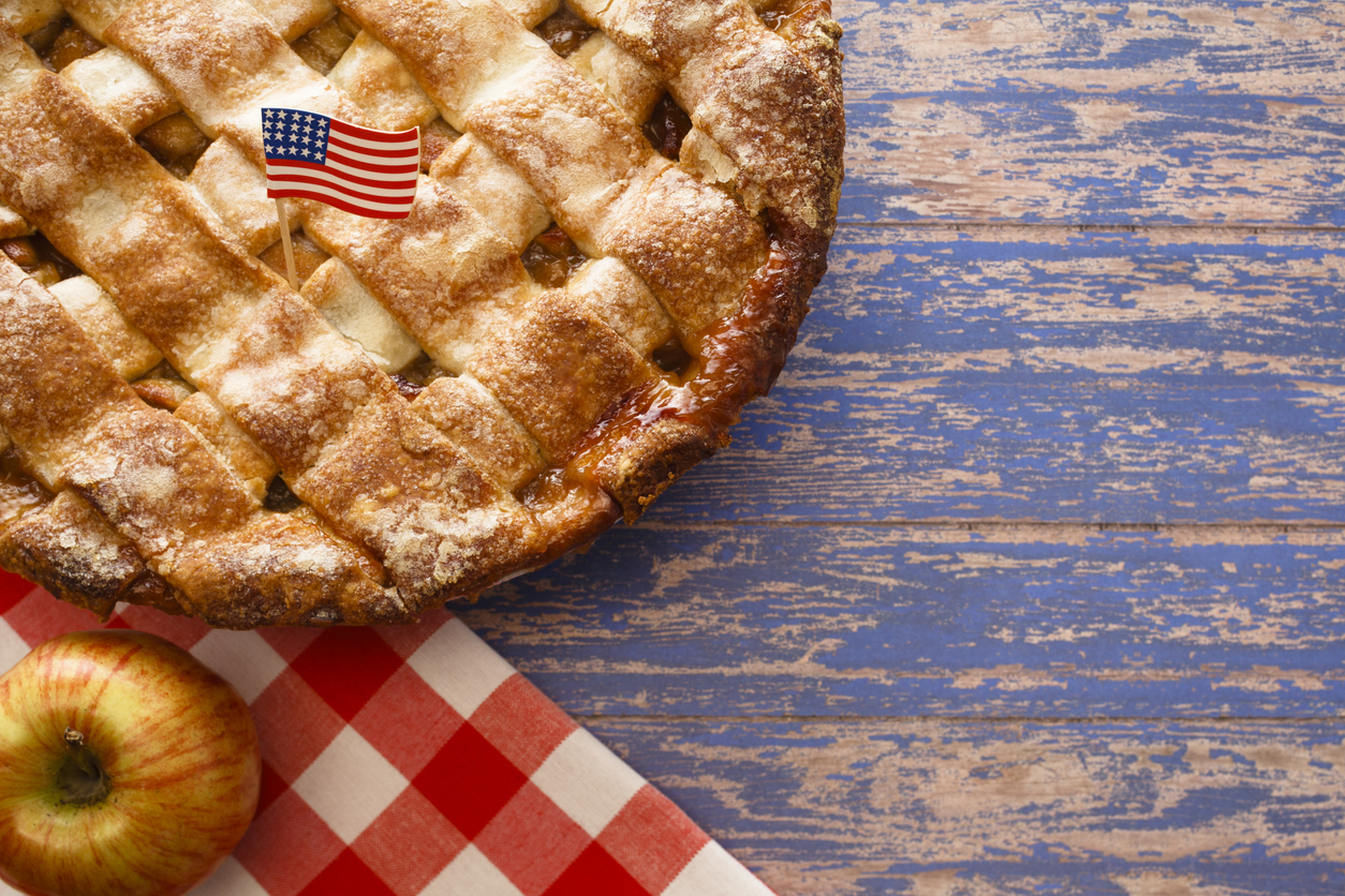 US flag on a latice crust apple pie. American as apple pie self-employed concept