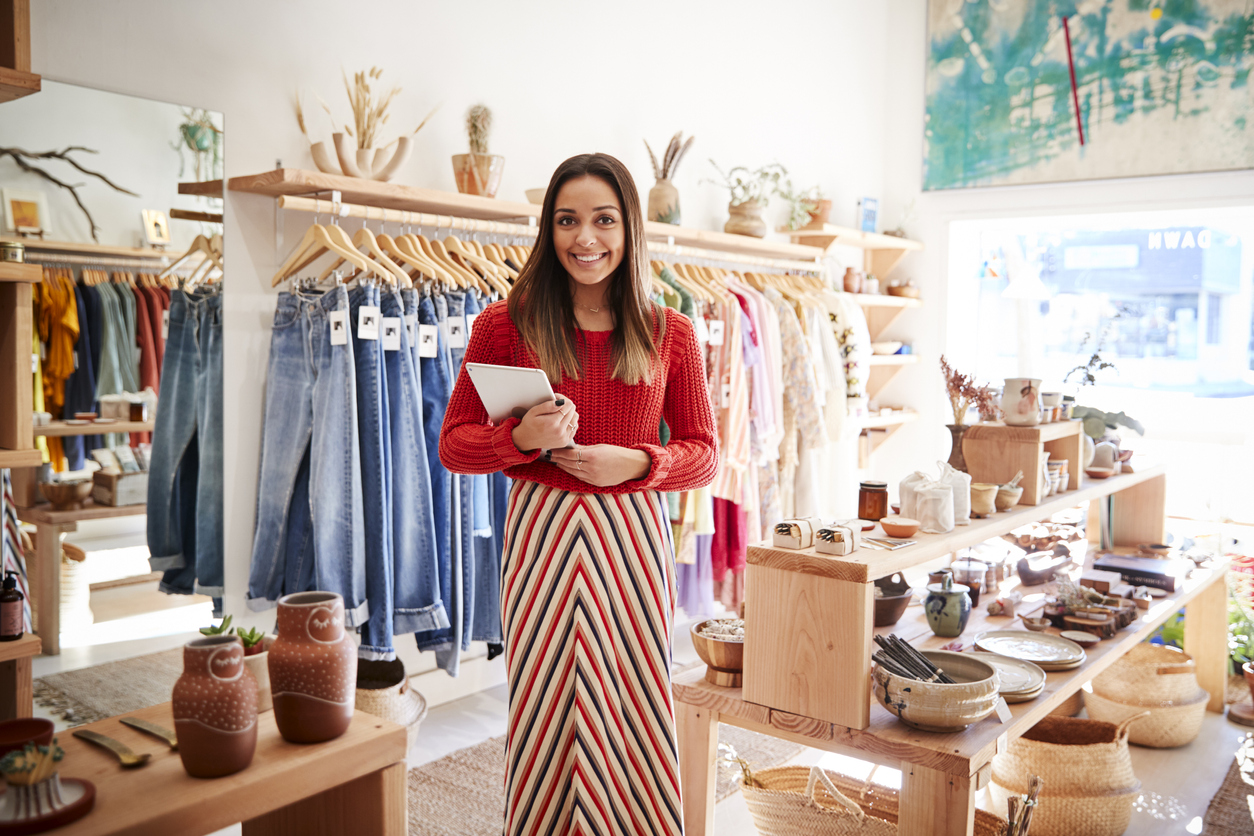 small business owner standing in front of her merchandise
