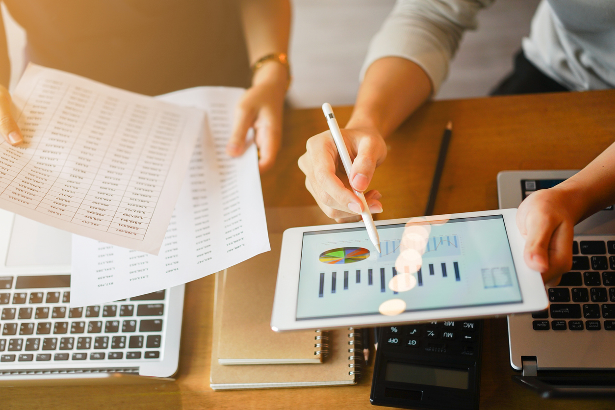CPA looking over small business's accounting records