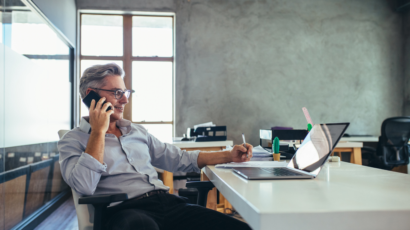 businessman on the phone in the office of his limited liability corporation